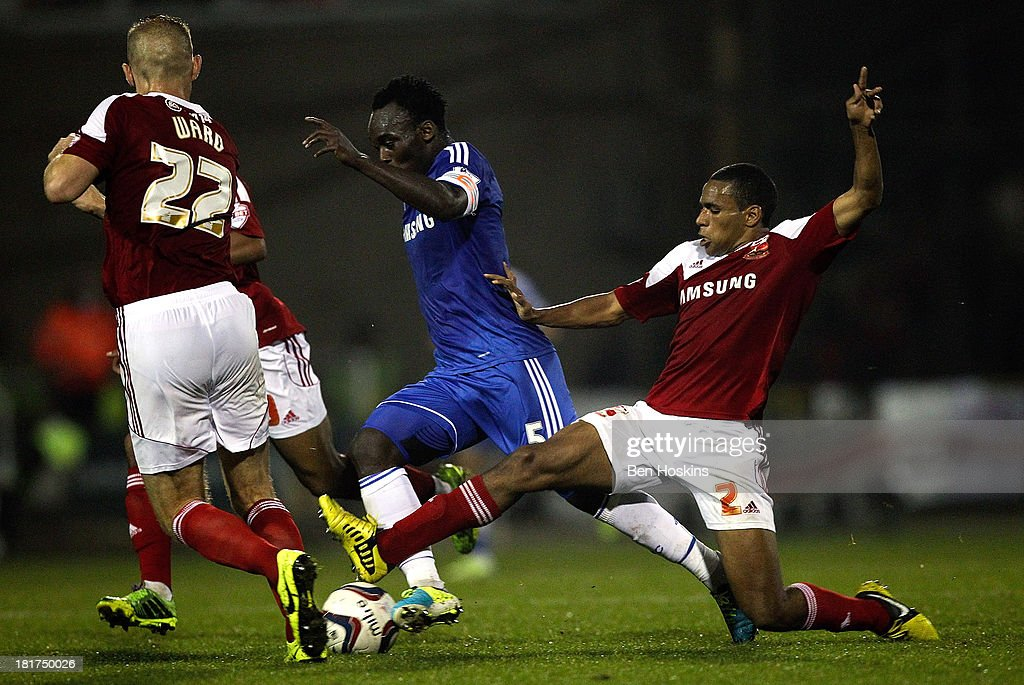 <a gi-track='captionPersonalityLinkClicked' href=/galleries/search?phrase=Michael+Essien&family=editorial&specificpeople=523500 ng-click='$event.stopPropagation()'>Michael Essien</a> of Chelsea is tackled by Nathan Thompson of Swindon during the Capital One Cup third round match between Swindon Town and Chelsea at County Ground on September 24, 2013 in Swindon, England.