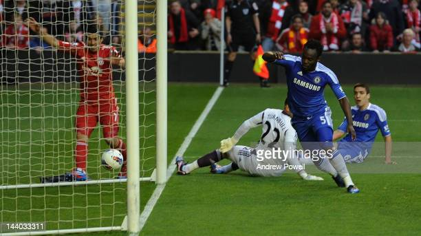 Michael Essien of Chelsea scores an own goal off a cross from Luis Suarez of Liverpool during the Barclays Premier League match between Liverpool and...
