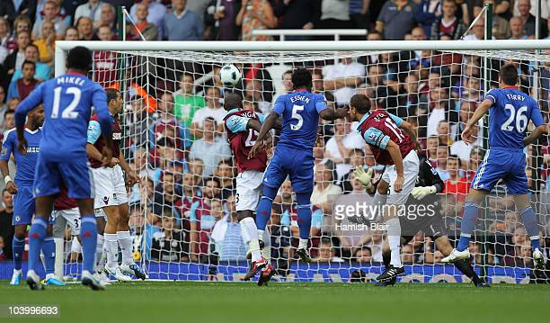Michael Essien of Chelsea scores their first goal with a header during the Barclays Premier League match between West Ham United and Chelsea at the...