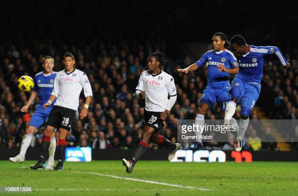 Michael Essien of Chelsea scores their first goal with a header during the Barclays Premier League match between Chelsea and Fulham at Stamford...