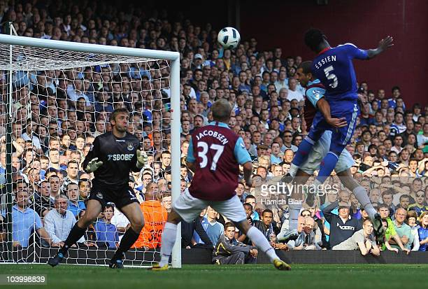 Michael Essien of Chelsea scores their third goal with a header during the Barclays Premier League match between West Ham United and Chelsea at the...