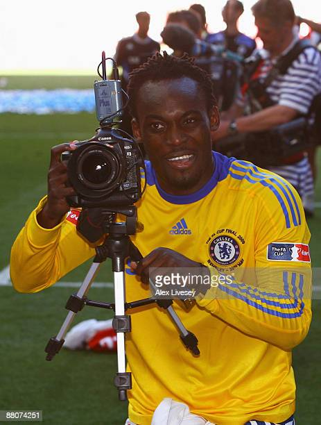 Michael Essien of Chelsea takes photographs following victory during the FA Cup sponsored by EON Final match between Chelsea and Everton at Wembley...