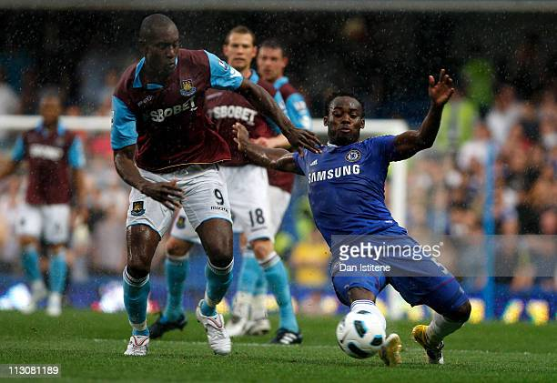 Michael Essien of Chelsea wins the ball ahead of Carlton Cole of West Ham during the Barclays Premier League match between Chelsea and West Ham...