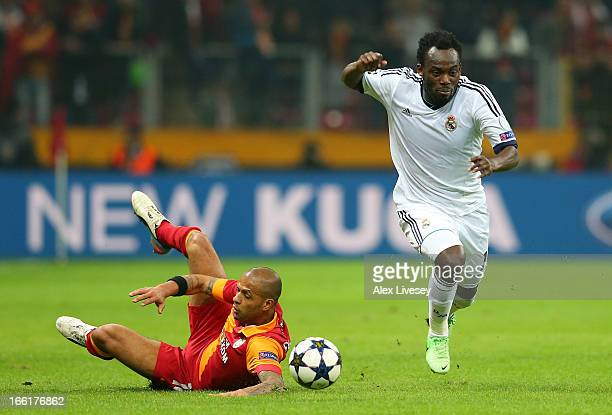 Michael Essien of Real Madrid beats a slide tackle from Felipe Melo of Galatasaray AS during the UEFA Champions League Quarter Final match between...