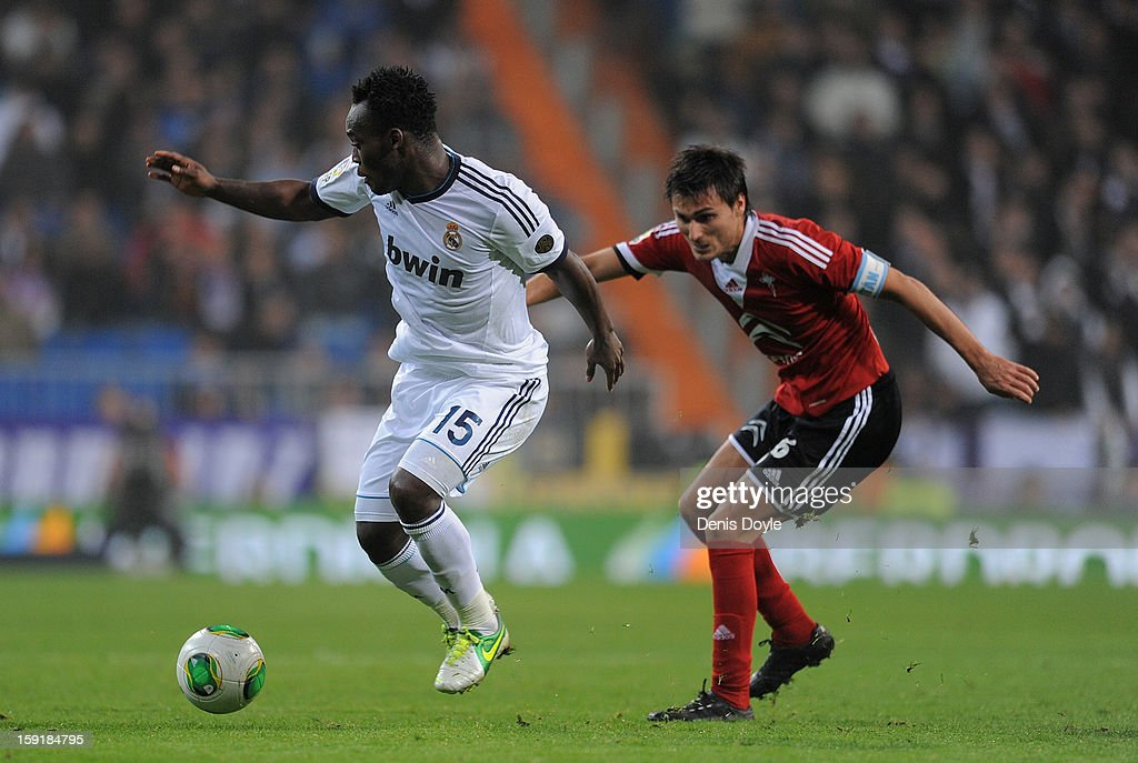 Michael Essien (L) of Real Madrid CF battles for the ball against Jonathan Vila of Celta de Vigo during the Copa del Rey round of sixteen second leg match between Real Madrid CF and Real Club Celta de Vigo at Estadio Santiago Bernabeu on January 9, 2013 in Madrid, Spain.