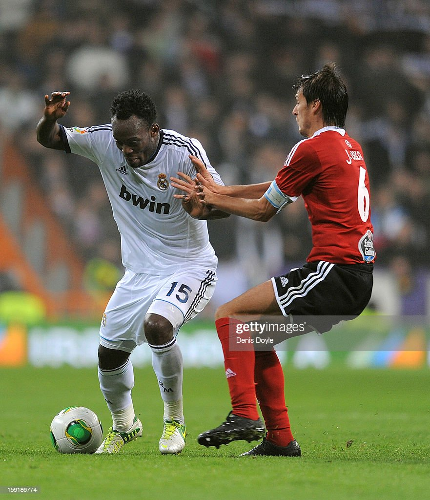 Michael Essien (L) of Real Madrid CF battles for the ball against Jonathan Vila of Celta de Vigo during the Copa del Rey round of 16 second leg match between Real Madrid and Celta de Vigo at Estadio Santiago Bernabeu on January 9, 2013 in Madrid, Spain.