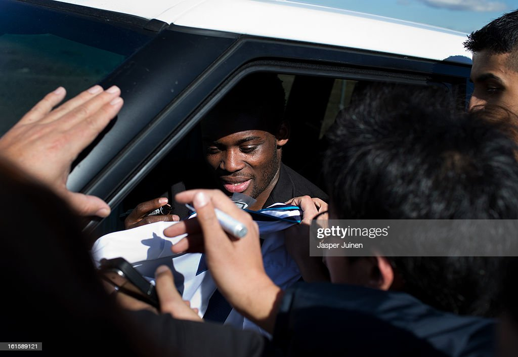 Michael Essien of Real Madrid signs autographs to fans waiting outside the Real Madrid training ground after a training session ahead of the UEFA Champions League match between Real Madrid CF and Manchester United at the Valdebebas training ground on February 12, 2013 in Madrid, Spain.