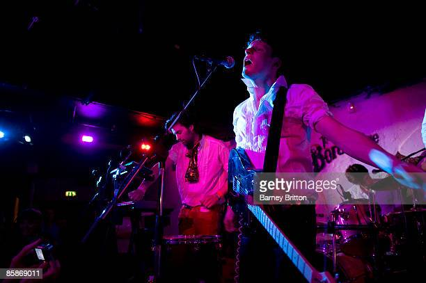 Michael Evans and Tom Burke of Official Secrets Act perform on stage at Borderline on April 8 2009 in London England