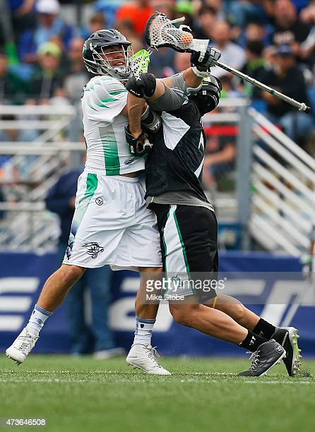 Michael Evans of the Chesapeake Bayhawks and John Austin of the New York Lizards battle for the ball at James M Shuart Stadium on May 16 2015 in...