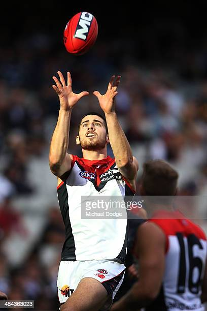 Michael Evans of the Demons marks the ball during the round four AFL match between the Carlton Blues and the Melbourne Demons at Melbourne Cricket...