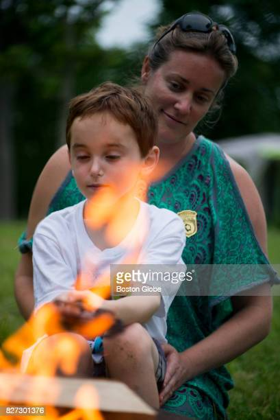 Michael Farina and his mom Kaitlyn Shinney Farina cook hotdogs for the family during the annual World End's Reservation overnight camping event in...