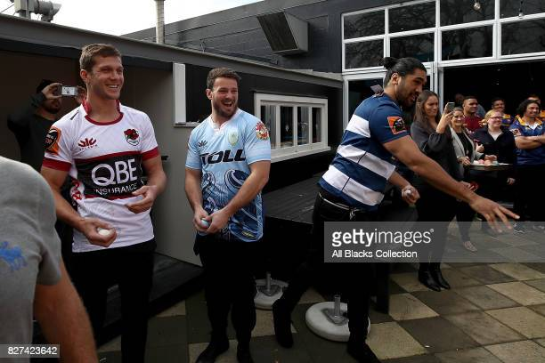 Michael Fatialofa Matt Duffie and Matt Moulds throw paint bombs at a map of New Zealand during the Mitre 10 Cup Season Launch at the College Rifles...