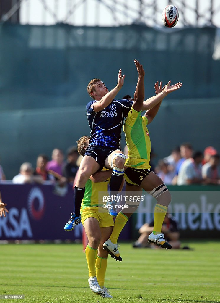 Michael Fedo of Scotland and Jordan Tuapou of Australia in the Dubai Bowl Quarter Final match during the Emirates IRB Dubai Sevens, Round 2 of the HSBC Sevens World Series on December 1, 2012 in Dubai, United Arab Emirates.