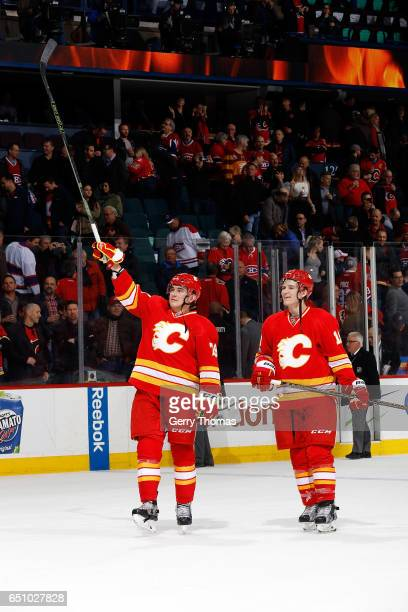 Michael Ferland and Matthew Tkachuk of the Calgary Flames acknowledge the crowd after an NHL game against the Montreal Canadiens on March 9 2017 at...