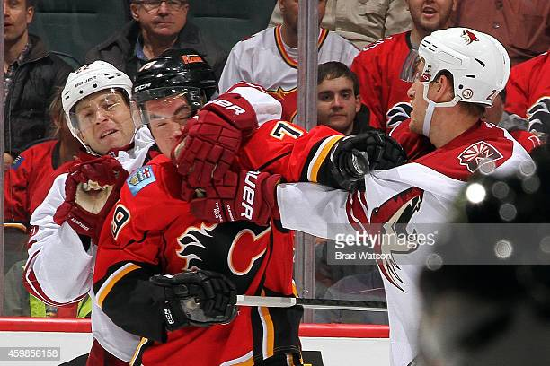 Michael Ferland of the Calgary Flames gets into a postwhistle scrum against Michael Stone and Brandon McMillan of the Arizona Coyotes at Scotiabank...