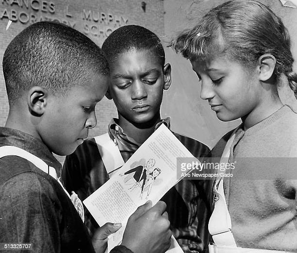 Michael Finch Myron Johnson and Miss Dennis Shipley in a classroom October 9 1962