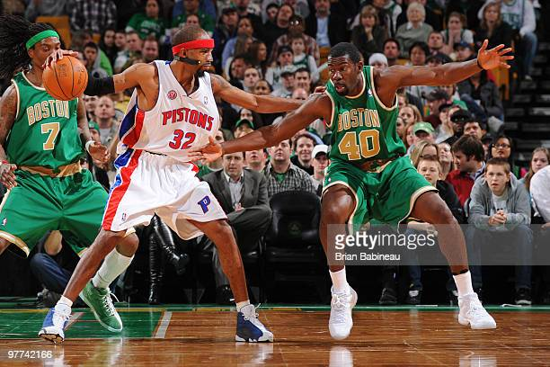 Michael Finley of the Boston Celtics reaches in for the ball against Richard Hamilton of the Detroit Pistons on March 15 2010 at the TD Garden in...