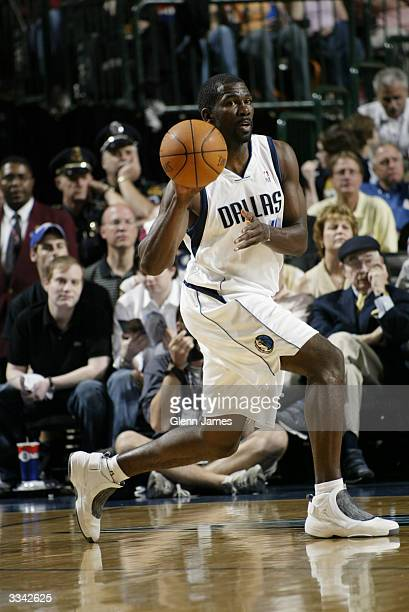 Michael Finley of the Dallas Mavericks passes the ball during the game against the Phoenix Suns at American Airlines Arena on April 3 2004 in Dallas...