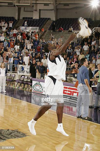 Michael Finley of the Dallas Mavericks throws a shoe to the crowd after an intrasquad exhibition at the Mavs Fan Jam on October 9 2004 at Texas...