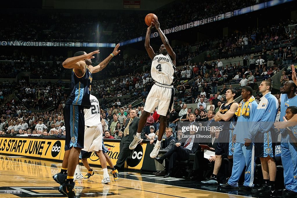 Michael Finley #4 of the San Antonio Spurs shoots against Marcus Camby #23 of the Denver Nuggets in Game One of the Western Conference Quarterfinals during the 2007 NBA Playoffs at AT&T Center on April 22, 2007 in San Antonio, Texas. The Nuggets won 95-89.