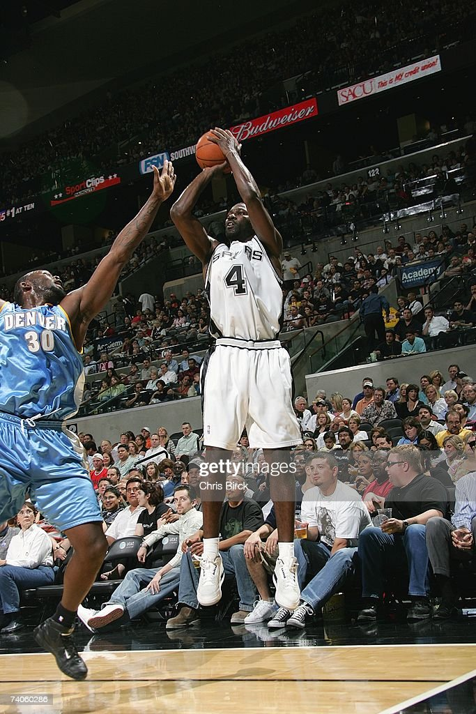 Michael Finley #4 of the San Antonio Spurs shoots against Reggie Evans #30 of the Denver Nuggets at AT&T Center on April 18, 2007 in San Antonio, Texas. The Nuggets won 100-77.