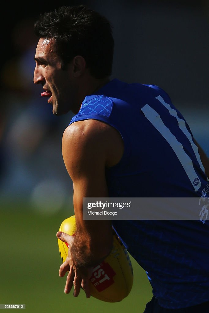 <a gi-track='captionPersonalityLinkClicked' href=/galleries/search?phrase=Michael+Firrito&family=editorial&specificpeople=221362 ng-click='$event.stopPropagation()'>Michael Firrito</a> of the Kangaroos looks upfield during a North Melbourne Kangaroos AFL media session at Arden Street Ground on May 5, 2016 in Melbourne, Australia.