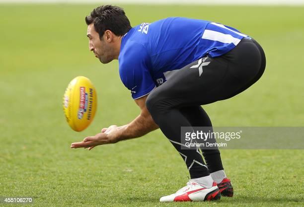 Michael Firrito of the Kangaroos marks during a North Melbourne Kangaroos AFL training session at Arden Street Ground on September 10 2014 in...