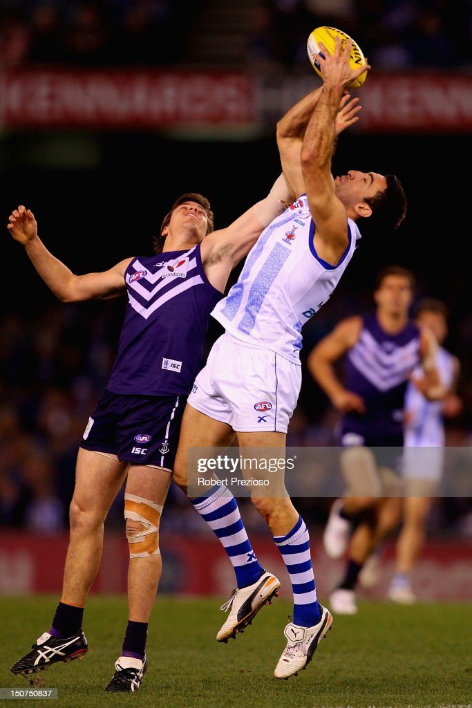 <a gi-track='captionPersonalityLinkClicked' href=/galleries/search?phrase=Michael+Firrito&family=editorial&specificpeople=221362 ng-click='$event.stopPropagation()'>Michael Firrito</a> of the Kangaroos takes a mark during the round 22 AFL match between the North Melbourne Kangaroos and the Fremantle Dockers at Etihad Stadium on August 26, 2012 in Melbourne, Australia.