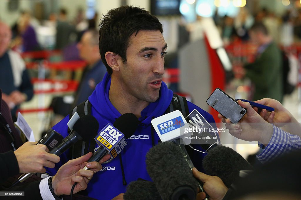 <a gi-track='captionPersonalityLinkClicked' href=/galleries/search?phrase=Michael+Firrito&family=editorial&specificpeople=221362 ng-click='$event.stopPropagation()'>Michael Firrito</a> of the North Melbourne Kangaroos speaks to the media at Melbourne Airport on September 7, 2012 in Melbourne, Australia.
