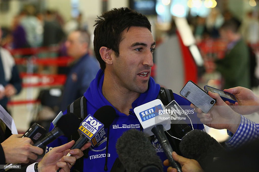 Michael Firrito of the North Melbourne Kangaroos speaks to the media at Melbourne Airport on September 7, 2012 in Melbourne, Australia.
