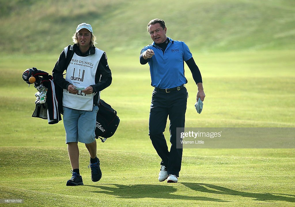 Michael Flatley with his caddy on the fourth hole during the third round of the Alfred Dunhill Links Championship on The Old Course, at St Andrews on September 28, 2013 in St Andrews, Scotland.