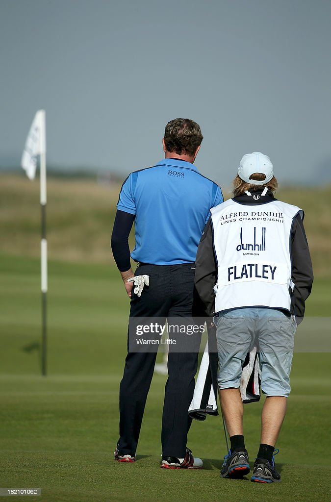 Michael Flatley with is caddy during the third round of the Alfred Dunhill Links Championship on The Old Course, at St Andrews on September 28, 2013 in St Andrews, Scotland.