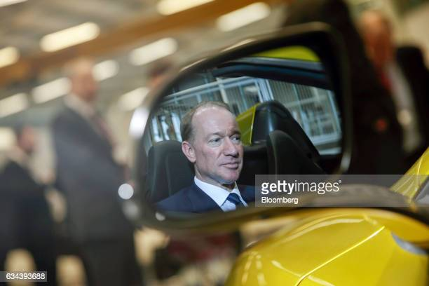 Michael Flewitt chief executive officer of McLaren Automotive Ltd is reflected in a wing mirror while sat in a McLaren 675LT automobile at a news...