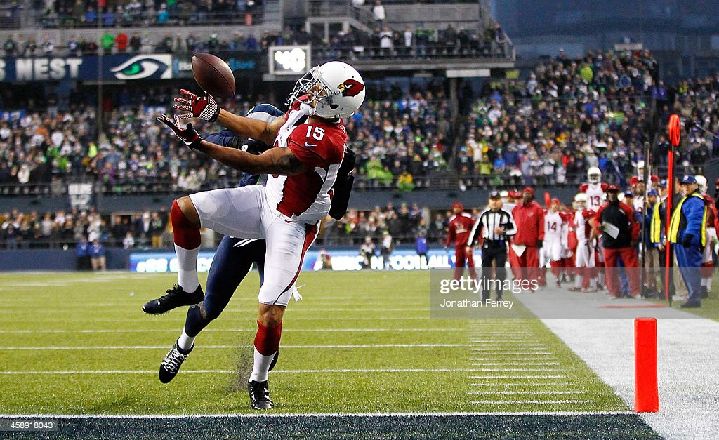Michael Floyd #15 of the Arizona Cardinals catches a touchdown against Byron Maxwell #41 of the Seattle Seahawks on December 22, 2013 at CenturyLink Field in Seattle, Washington.