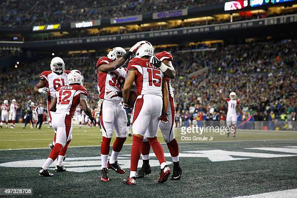 Michael Floyd of the Arizona Cardinals celebrates with teammates in the end zone after scoring a touchdown during the second quarter against the...