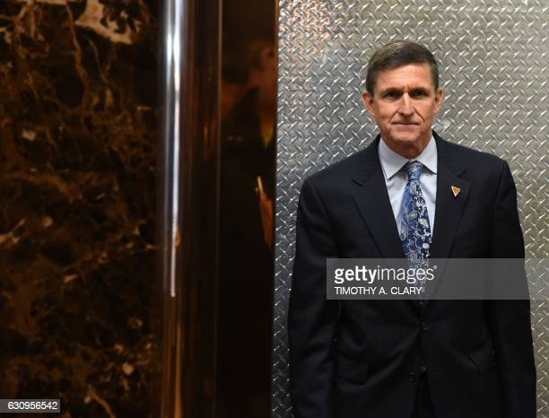 Michael Flynn national security adviser designate arrives at Trump Tower for meetings with US Presidentelect Donald Trump January 4 2017 in New York...