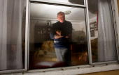 Michael Forbes looks out of a window of his property which he is refusing to sell to Donald Trump next to the Menie Estate on November 21 2007 in...