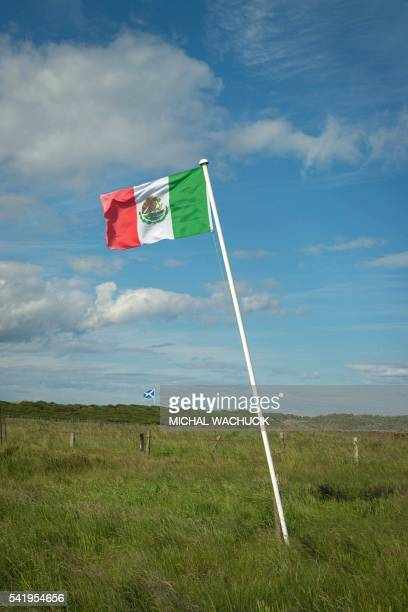 Michael Forbes' Mexican flag erected alongside Donald Trump's International Golf Links course north of Aberdeen on the East coast of Scotland on June...