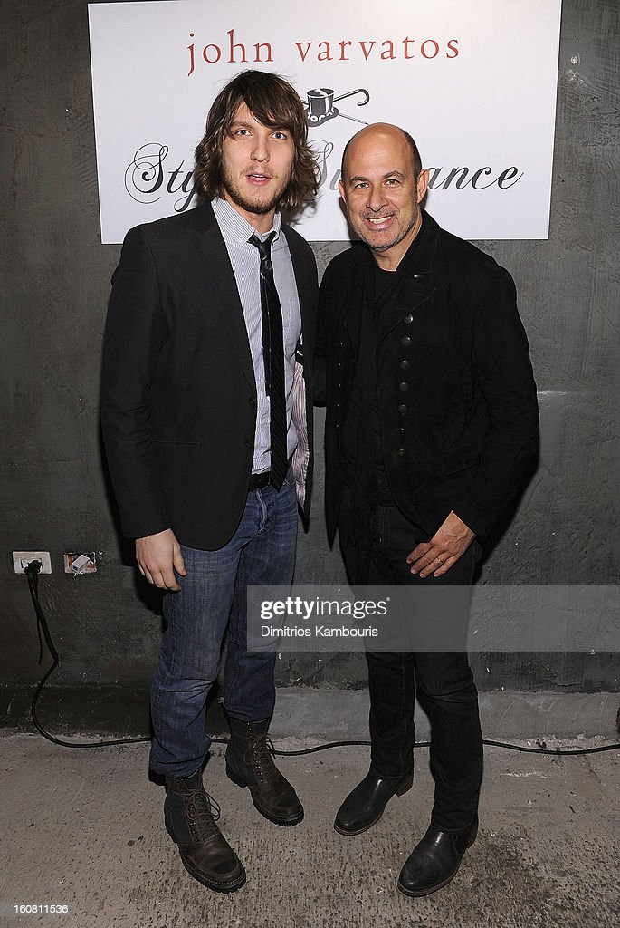 Michael Foster (L) and designer John Varvatos pose for a picture as they Celebrate The New JohnVarvatos.com on February 5, 2013 in New York City.