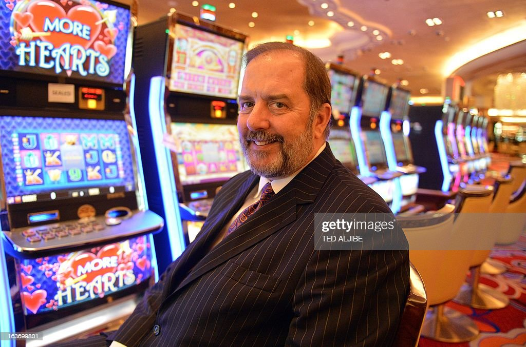 Michael French, chief operating officer of Solaire Resorts and casino, poses for photo next to gaming machines inside the casino in Manila on March 14, 2013, ahead of its opening on March 16. The Philippines makes its biggest bet this weekend in a high-stakes bid to join the world's elite gaming destinations, with the launch of a $1.2-billion casino on Manila Bay.Solaire Manila Resorts is the first of four enormous entertainment venues slated to rise over a giant chunk of prime, reclaimed land that industry and government leaders expect will attract millions of cashed-up Asian tourists.