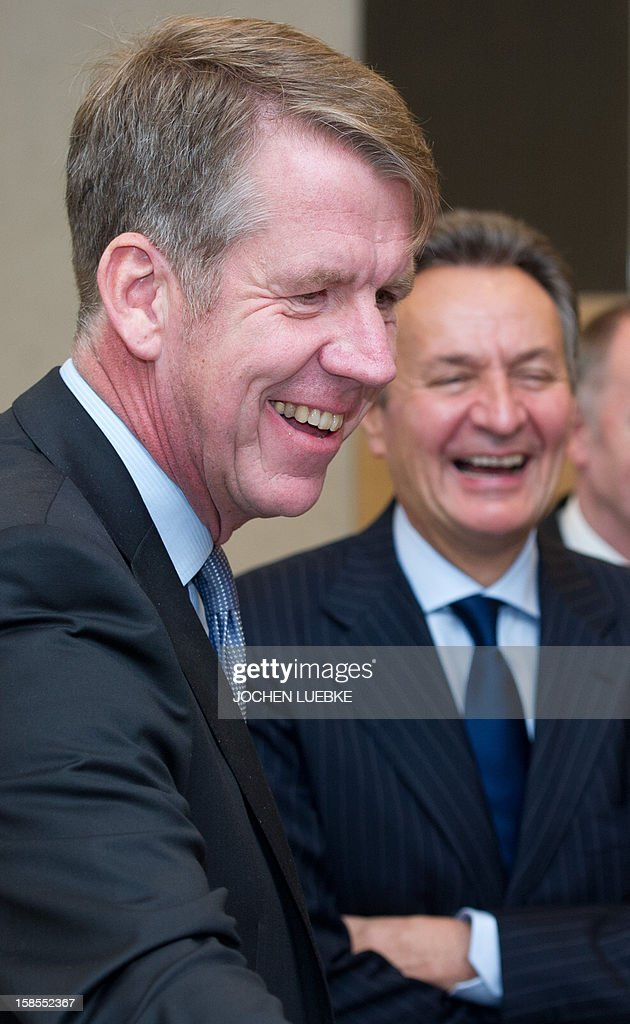 Michael Frenzel (R), outgoing chairman of German tourism giant TUI, and his successor Friedrich Joussen stand together on the sidelines of a press conference in Hanover, central Germany, on December 19, 2012. TUI posted a net loss for the 2012 financial year due to difficulties at shipping company Hapag Lloyd in which it holds a stake.