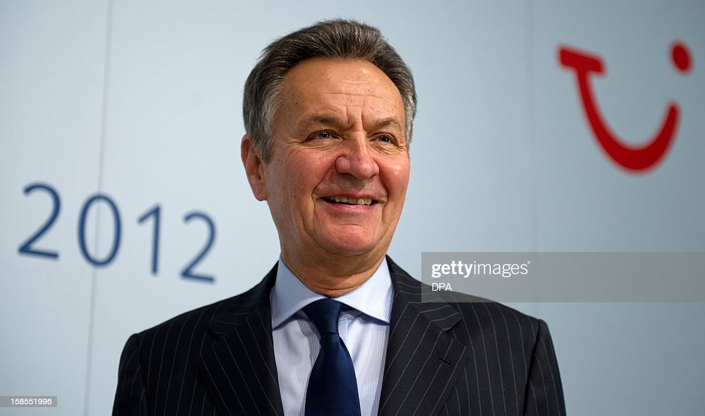 Michael Frenzel, outgoing chairman of German tourism giant TUI, stands in front of his company's logo on the sidelines of a press conference in Hanover, central Germany, on December 19, 2012. TUI posted a net loss for the 2012 financial year due to difficulties at shipping company Hapag Lloyd in which it holds a stake.