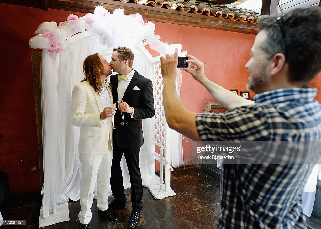 Michael Frey, 38 (L) kiises his partner Tim Campbell as a friend takes their picture during a wedding celebration at The Abbey after their wedding ceremony on July 1, 2013 in West Hollywood, California. The U.S. Ninth Circuit Court of Appeals lifted California's ban on same-sex marriages just three days after the Supreme Court ruled that supporters of the ban, Proposition 8, could not defend it before the high court. California Gov. Jerry Brown ordered all counties in the state to begin issuing licenses immediately.