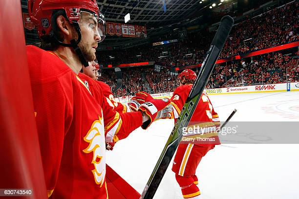 Michael Frolik and Jyrki Jokipakka of the Calgary Flames celebrate a goal against the Arizona Coyotes during an NHL game on December 31 2016 at the...