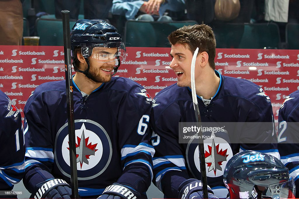 Michael Frolik #67 and Mark Scheifele #55 of the Winnipeg Jets share a laugh on the bench prior to puck drop against the St. Louis Blues at the MTS Centre on October 18, 2013 in Winnipeg, Manitoba, Canada.