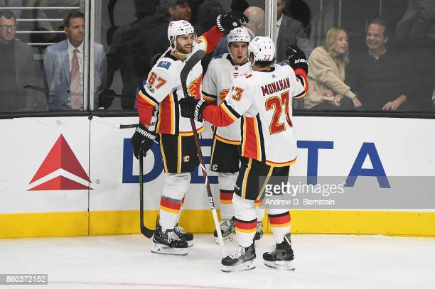 Michael Frolik Johnny Gaudreau and Sean Monahan of the Calgary Flames celebrate a goal against the Los Angeles Kings at STAPLES Center on October 11...