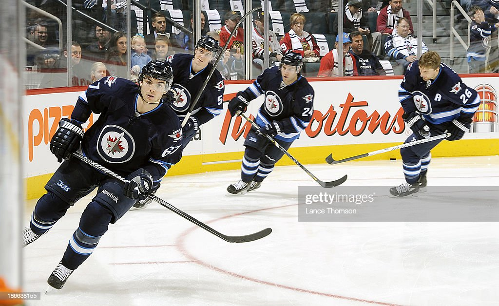 Michael Frolik #67, Mark Scheifele #55, Grant Clitsome #24 and Blake Wheeler #26 of the Winnipeg Jets take part in the pre-game warm up prior to NHL action against the Chicago Blackhawks at the MTS Centre on November 2, 2013 in Winnipeg, Manitoba, Canada.