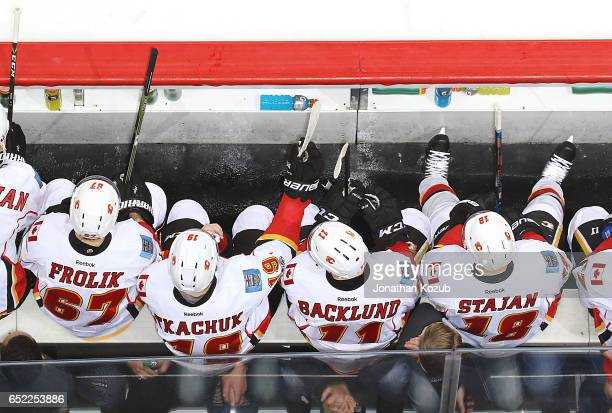Michael Frolik Matthew Tkachuk Mikael Backlund and Matt Stajan of the Calgary Flames look on from the bench during second period action against the...