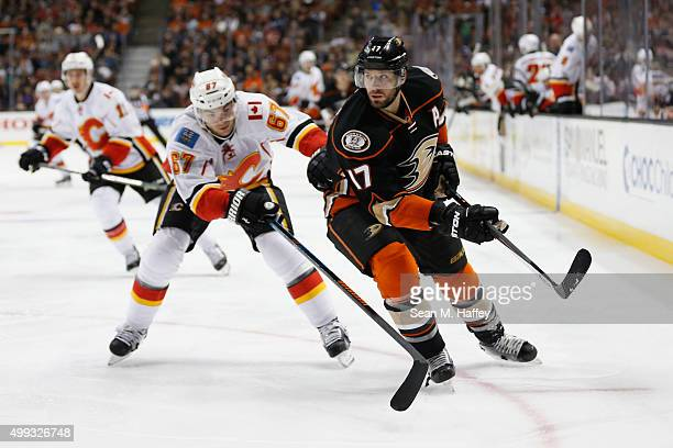 Michael Frolik of the Calgary Flames and Ryan Kesler of the Anaheim Ducks battle for a loose puck during a game at Honda Center on November 24 2015...