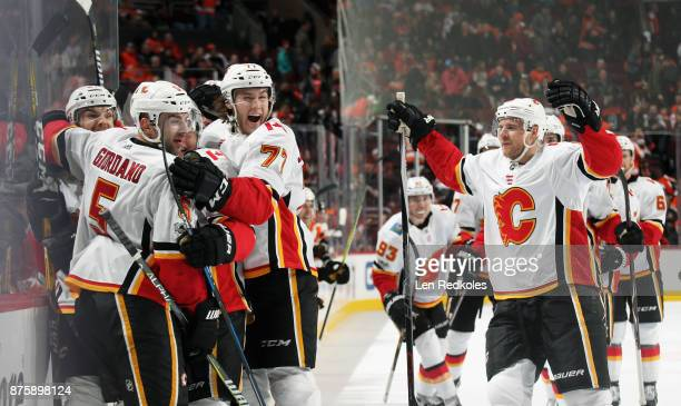 Michael Frolik of the Calgary Flames celebrates with his teammates after scoring the gamewinning goal in overtime to defeat the Philadelphia Flyers...